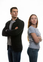 Woman and a man in a grudge look past each other