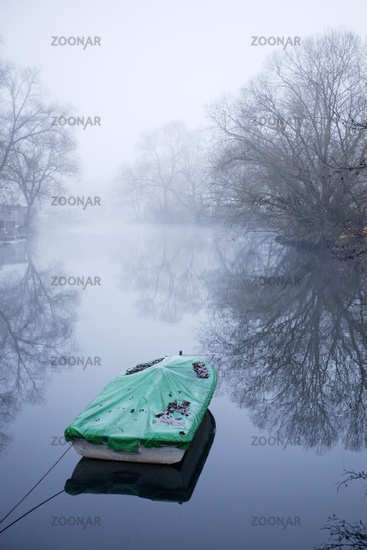 Boat in the fog on the river Ruhr, Germany