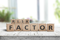 Risk factor sign on a wooden table