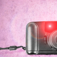 An old film plastic camera over grunge background