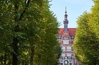 The main building of Gdansk University of Technology or Politechnika Gdanska among trees on the approaching alley