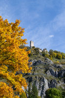 The ruin of Randeck castle in Markt Essing, Bavaria, Germany in autumn with multicolored tree in foreground