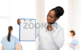 african american female doctor with clipboard