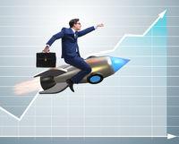 Businessman flying on rocket in business concept