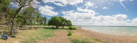Panoramic white sandy shore and fresh water impoundment in Joe Pool, Lynn Creek Park outside Dallas, Texas