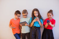 Modern generation feeling happy using smartphones and tablets