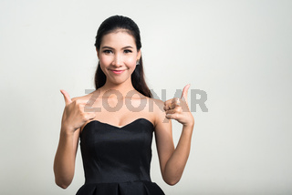 Portrait of young beautiful Asian businesswoman against white background