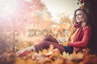 Young woman in autumn park,