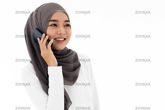 Muslim girl using mobile phone