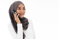 Muslim girl using mobile phone