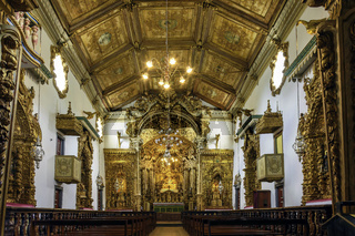 Interior of old historic 18th century church in gold-plated baroque style