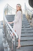 Beautiful young woman posing standing