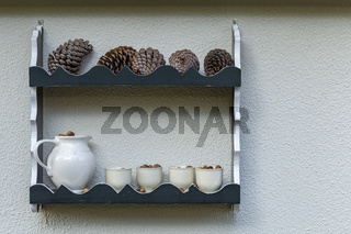 Rack with pinecone and cups