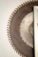 several saw blades for a circular saw hanging on a wall