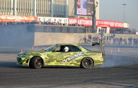Sports car team Garage-13 drifts with smoke on the Virage at the