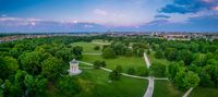 Aerial view over Munich and its popular Englischer Garten, very green and symbolic healthy park of the bavarian capital in summer, tourism hot spot.