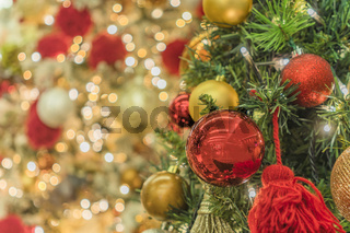 Blur bokeh background of Christmas tree ornament lights with glitter decoration balls