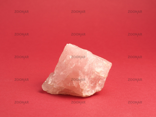 Rose quartz on a red background