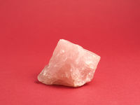 Rose quartz on a red background