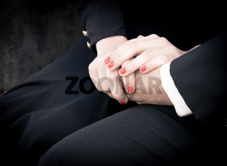 Young teenage couple holding hands