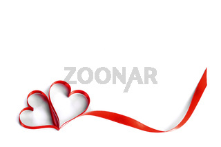 Heart shaped red ribbon on white
