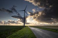 beautiful sunset light over windmills in Netherlands