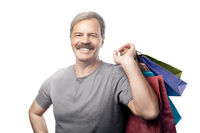 smiling mature man holding shopping bags isolated