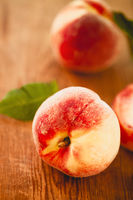 Group of fresh peaches on wood background