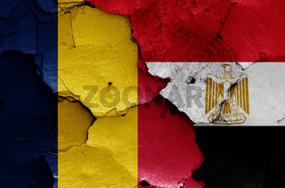 flags of Chad and Egypt painted on cracked wall