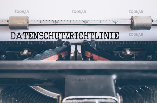word DATENSCHUTZRICHTLINIE written on vintage manual typewriter