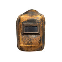 Aged thirty years old welding mask with traces of wear, front view. Isolated on white