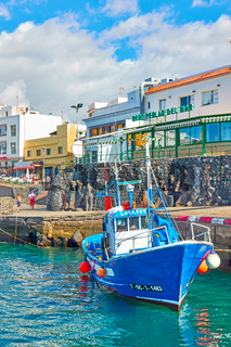Fishing boat and seafood restaurants at waterfront in Los Abrigos