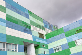 Industrial building against gray sky