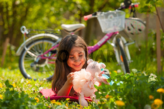 The wonderful holiday with a bicycle and a favorite toy