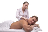 Masseuse doing massage on back of male client