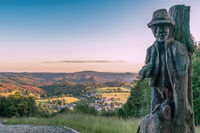 View from the Wachberg mountain across Saupsdorf village at sunset