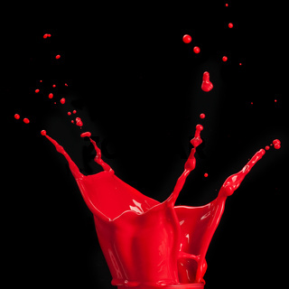 splash of red paint isolated on black