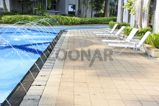 Resort area with swimming pool and chaise lounges