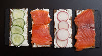 Sandwiches with salmon and vegetables
