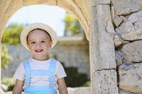 Satisfied boy in hat enjoying vacation