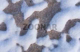 Snow patterns in the sand.