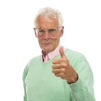 Senior man in green sweater thumbs up