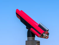 Pink coin telescope and blue sky