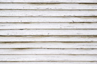 White painted rustic wood planks background with flaking paint. Stavanger, Norway.
