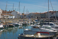 View of a port and harbour with boats in Saint Martin Ile de Re in France.