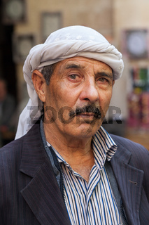 Portrait of an unidentified Kurdish man with his traditional head scar in Sanli Urfa province of Anatolia, Turkey