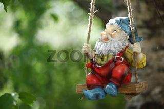 garden dwarf on green nature background