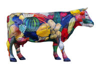 Model of a cow is ornamented by vegetables and fruit