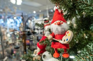 santa clause toy hanging on christmas tree