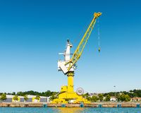 Yellow crane on the Adour River in Bayonne, France